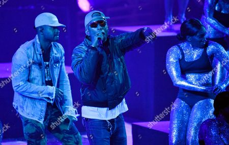 "Pharrell Williams, Shay Haley. Pharrell Williams, center, and Shay Haley, left, of the band N.E.R.D. perform their song ""Lemon"" during the 2018 iHeartRadio Music Awards at The Forum, in Inglewood, Calif"