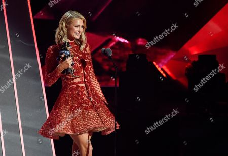 Paris Hilton and her dog Diamond Baby take the stage during the 2018 iHeartRadio Music Awards at The Forum, in Inglewood, Calif
