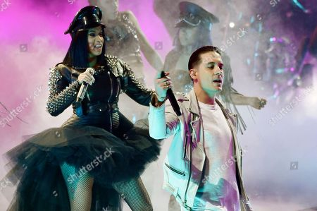G-Eazy, Cardi B. G-Eazy, right, and Cardi B perform together during the 2018 iHeartRadio Music Awards at The Forum, in Inglewood, Calif