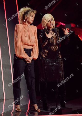 Rita Ora, Babe Rexha. Rita Ora, left, and Bebe Rexha present the Best Collaboration Award during the 2018 iHeartRadio Music Awards at The Forum, in Inglewood, Calif