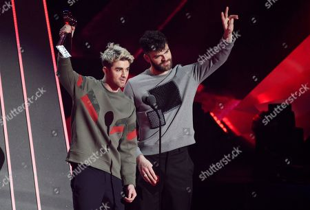 Alex Pall, Andrew Taggart. Andrew Taggart, left, and Alex Pall of The Chainsmokers accept the Best Collaboration award during the 2018 iHeartRadio Music Awards at The Forum, in Inglewood, Calif