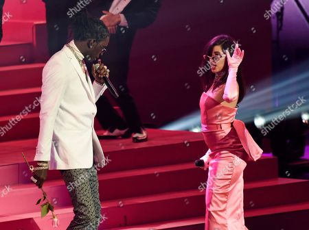 Camila Cabello, Young Thug. Singer Camila Cabello, right, is joined by Young Thug during her performance at the 2018 iHeartRadio Music Awards at The Forum, in Inglewood, Calif