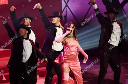 Singer Camila Cabello, center, performs with backup dancers during the 2018 iHeartRadio Music Awards at The Forum, in Inglewood, Calif