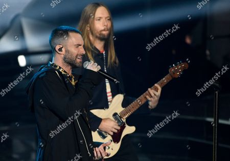 Adam Levine, James Valentine. Adam Levine, left, and James Valentine of Maroon 5 perform during the 2018 iHeartRadio Music Awards at The Forum, in Inglewood, Calif