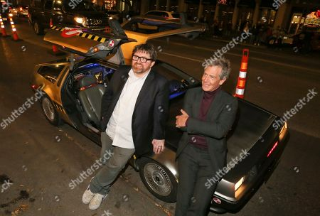 "Ernie Cline, Ben Mendelsohn. Ernie Cline, left, and Ben Mendelsohn sit on a DeLorean after arriving for the world premiere of ""Ready Player One"" during the South by Southwest Film Festival at the Paramount Theatre, in Austin, Texas"