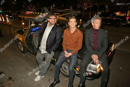 "Ernie Cline, Tye Sheridan, Ben Mendelsohn. Ernie Cline, Tye Sheridan and Ben Mendelsohn, from left, sit on a DeLorean after arriving for the world premiere of ""Ready Player One"" during the South by Southwest Film Festival at the Paramount Theatre, in Austin, Texas"