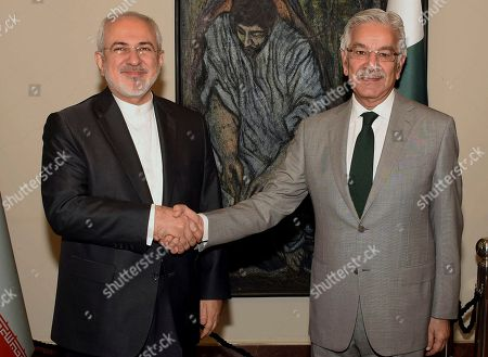 Mohammad Javad Zarif, Khawaja Muhammad Asif. In this photo released by the Press Information Department, visiting Iranian Foreign Minister Mohammad Javad Zarif, left, shakes hands with his Pakistani counterpart Khawaja Muhammad Asif prior to their meeting in Islamabad, Pakistan