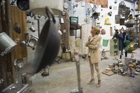 Brigitte Trogneux visits the showroom of Indian artist Subodh Gupta