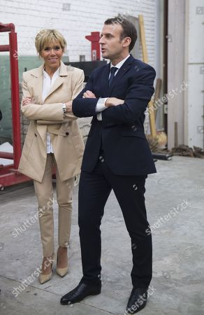 French President Emmanuel Macron and his wife Brigitte Trogneux visit the showroom of Indian artist Subodh Gupta
