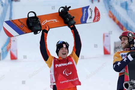 Winners of the Men's Snowboard Cross SB-LL1 event silver medalist Chris Vos of Netherlands poses for photos during a ceremony at the 2018 Winter Paralympics in Pyeongchang, South Korea