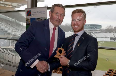 Graham Gooch (L) presents Adam Wheater (R) with his County Championship winning medal during the Lord's Taverners Presentation at Lord's Cricket Ground on 12th March 2018