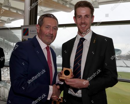 Graham Gooch (L) presents Matt Quinn (R) with his County Championship winning medal during the Lord's Taverners Presentation at Lord's Cricket Ground on 12th March 2018