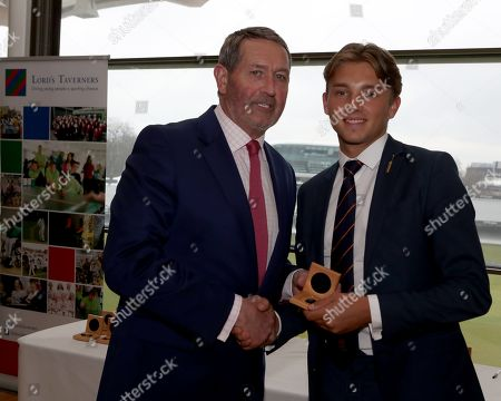Graham Gooch (L) presents Aaron Beard (R) with his County Championship winning medal during the Lord's Taverners Presentation at Lord's Cricket Ground on 12th March 2018