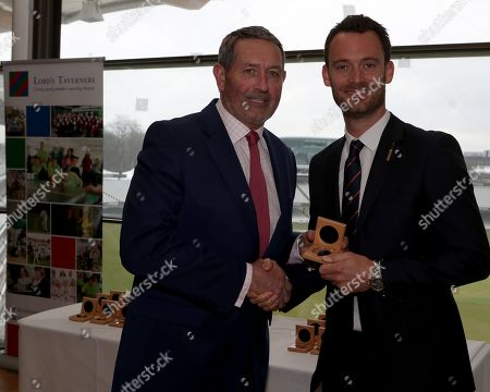 Stock Photo of Graham Gooch (L) presents James Foster (R) with his County Championship winning medal during the Lord's Taverners Presentation at Lord's Cricket Ground on 12th March 2018