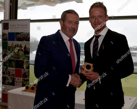 Graham Gooch (L) presents Tom Westley (R) with his County Championship winning medal during the Lord's Taverners Presentation at Lord's Cricket Ground on 12th March 2018