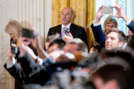 Gary Cohn, Kellyanne Conway. Outgoing White House chief economic adviser Gary Cohn, center, and Counselor to the President Kellyanne Conway, left, arrive for a ceremony in the East Room of the White House in Washington, where President Donald Trump honored the World Series Champion Houston Astros for their 2017 World Series victory