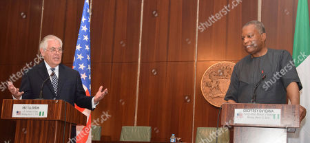 Nigeria's Minister of Foreign Affairs Geoffrey Onyeama, right, listens to U.S. Secretary of State Rex Tillerson during a media conference at the Presidential Villa in Abuja, Nigeria