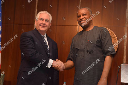 U.S. Secretary of State Rex Tillerson, left, is welcome by Nigeria's Minister of Foreign Affairs Geoffrey Onyeama, at the Presidential Villa in Abuja, Nigeria