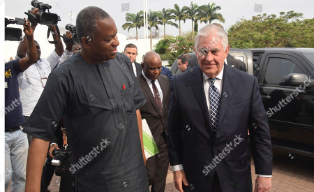Nigeria's Minister of Foreign Affairs Geoffrey Onyeama, left, walks with U.S. Secretary of State Rex Tillerson upon his arrival at the Presidential Villa in Abuja, Nigeria