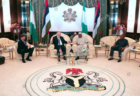 In this photo released by the Nigeria State House, from left, U.S. Ambassador to Nigeria W. Stuart Symington, U.S. Secretary of State Rex Tillerson, Nigeria's President Muhammadu Buhari, and Nigeria's Minister of Foreign Affairs Geoffrey Onyeama, during a meeting at the Presidential Villa in Abuja, Nigeria