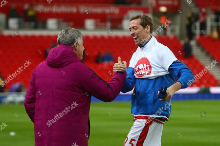 Brian Kidd of Manchester City greets Stoke's Peter Crouch