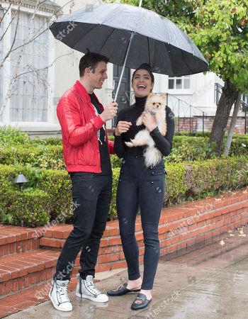 Tyler Regan and Rachel Levin brave the rain with her puppy 'Neyo Bambi'