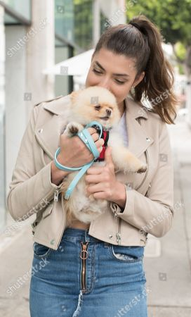 Stock Picture of Rachel Levin with her puppy 'Neyo Bambi'