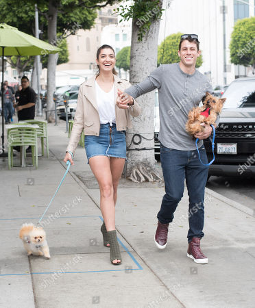 Stock Photo of Rachel Levin and Tyler Regan are spotted in Beverly Hills with their puppy 'Neyo Bambi' and 'Baggio'
