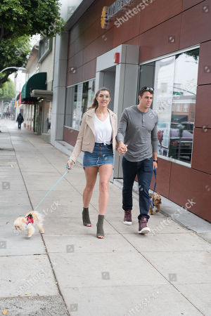 Stock Image of Rachel Levin and Tyler Regan are spotted in Beverly Hills with their puppy 'Neyo Bambi' and 'Baggio'