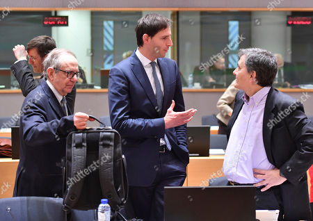 Dutch Finance Minister Wopke Hoekstra, center, speaks with Greek Finance Minister Euclid Tsakalotos, right, and Italian Finance Minister Pier Carlo Padoan, left, during a meeting of EU finance ministers at the Europa building in Brussels