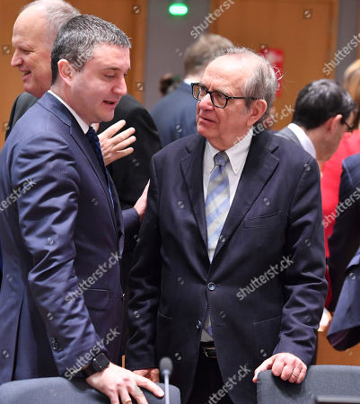 Bulgarian Finance Minister Vladislav Goranov, left, speaks with Italian Finance Minister Pier Carlo Padoan during a meeting of EU finance ministers at the Europa building in Brussels