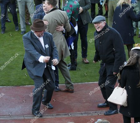 Tim Radford owner [left] and Mick Channon celebrate the win of Mister Whitaker in the Close Brothers Novices' Handicap Chase at Cheltenham.