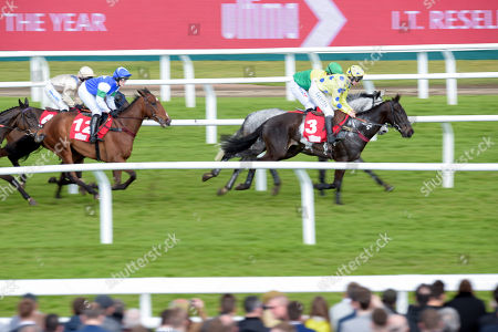 Vintage Clouds trained by Sue Smith and ridden by Danny Cook and Yala Enki trained by Venetia Williams and ridden by Charlie Deutsch lead in the Ultima Handicap Steeple Chase
