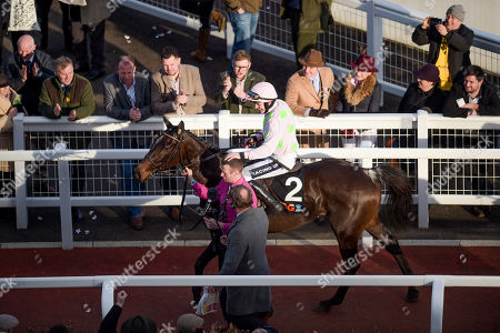 Ruby Walsh celebrates after winning the OLBG Mares' Hurdle Race (Registered as The David Nicholson Mares' Hurdle Race) on Benie Des Dieuz trained by Willie Mullins