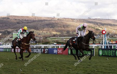 Benie Des Dieuz trained by Willie Mullins and ridden by Ruby Walsh (r) wins the 4.10pm The OLBG Mares' Hurdle Race(Registered As The David Nicholson Mares' Hurdle)