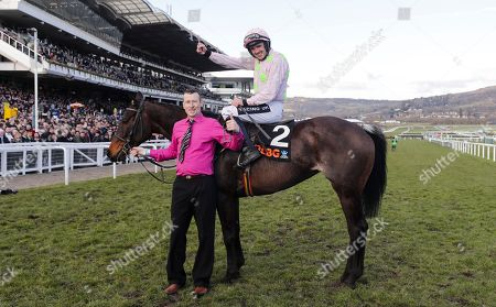 Ruby Walsh celebrates on Benie Des Dieuz trained by Willie Mullins after winning the 4.10pm The OLBG Mares' Hurdle Race(Registered As The David Nicholson Mares' Hurdle)