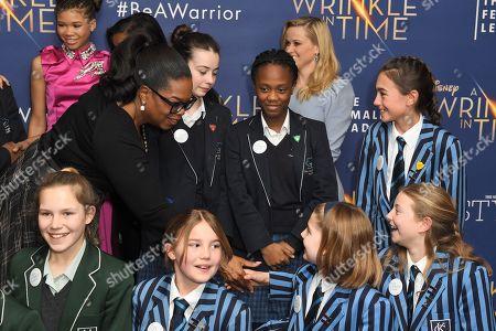 Oprah Winfrey and schoolchildren
