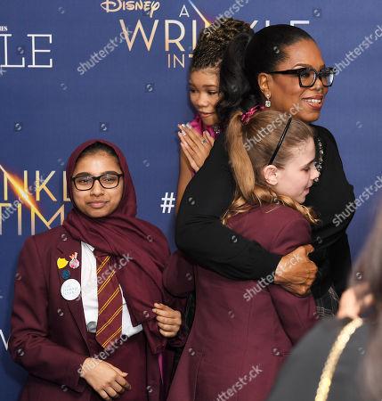 Oprah Winfrey and school children