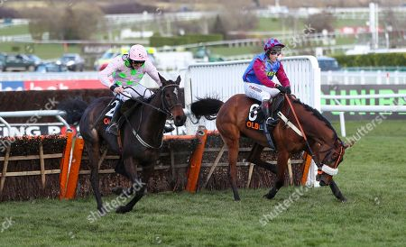 Ruby Walsh jumping the last fence on the way to winning the 4.10pm The OLBG Mares' Hurdle Race (Registered As The David Nicholson Mares' Hurdle) with Richard Johnson riding La Bague Au Roi (right)