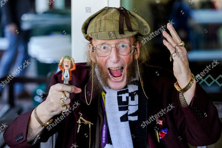 John McCririck reacts after the Ultima Handicap Chase