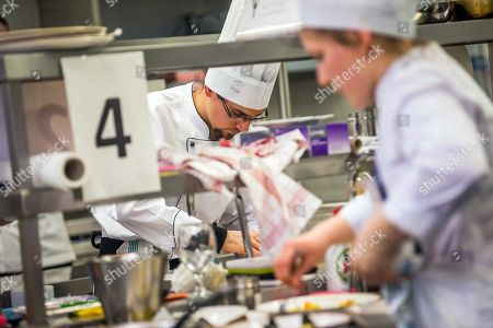 Contestants cook to impress the jury in the final round of the Eastern European section of the Olivier Roellinger chef competition in the training kitchen of the College of Commerce, Catering and Tourism of the Budapest Business School (BBS) in Budapest, Hungary, 13 March 2018. The Olivier Roellinger contest aims to bring together young chefs and students trained in the catering sector and encourage them to promote the preservation of marine resources through the use of sustainable species for fish and seafood dishes.