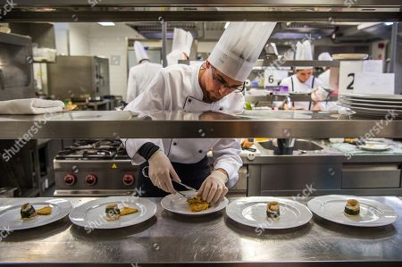 A contestant prepares dishes in the final round of the Eastern European section of the Olivier Roellinger chef competition in the training kitchen of the College of Commerce, Catering and Tourism of the Budapest Business School (BBS) in Budapest, Hungary, 13 March 2018. The Olivier Roellinger contest aims to bring together young chefs and students trained in the catering sector and encourage them to promote the preservation of marine resources through the use of sustainable species for fish and seafood dishes.