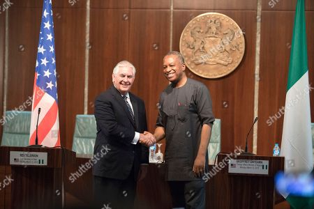 In this photo provided by the United States Department of State, U.S. Secretary of State Rex Tillerson shakes hands with Nigeria Foreign Minister Geoffrey Onyeama after their joint press availability at the Aso Rock Presidential Villa, Abuja, Nigeria