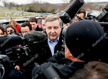 Republican Rick Saccone, center, is surrounded by cameras and reporters as he heads to the polling place to cast his ballot, in McKeesport, Pa. Saccone is running against Democrat Conor Lamb in a special election being held for the PA 18th Congressional District vacated by Republican Tim Murphy