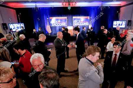 A crowd gathers in the ballroom of the Youghiogheny Country Club as they await returns for Republican Rick Saccone in the special election for the Pennsylvania 18th Congressional District seat vacated by Republican Tim Murphy, in McKeesport, Pa. Saccone is running against Democrat Conor Lamb