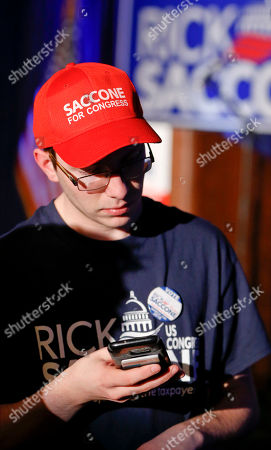 Rick Saccone Supporter. A supporter for Republican Rick Saccone checks his phone at the candidate's returns party just after the polls closed in a special election being held for the PA 18th Congressional District vacated by Republican Tim Murphy, in McKeesport, Pa. Saccone is running against Democrat Conor Lamb