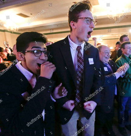 Khalid Husain, Demetrios Germanos. Khalid Husain, left, and Demetrios Germanos, right, watch the returns for a special election being held for the Pennsylvania 18th Congressional District vacated by Republican Tim Murphy, in McKeesport, Pa. Republican Rick Saccone is running against Democrat Conor Lamb. The Pennsylvania congressional race between Lamb and Saccone remains too close to call, with local elections officials still counting absentee ballots late Tuesday