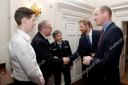 Prince William (R) and Prince Harry (2R) talk with Metropolitan Police Commissioner Cressida Dick (C) police officer of the year PC Philip Stone (2L), and police staff of the year, Claire Summers, during a reception for the winners of The Met Excellence Awards at Kensington Palace