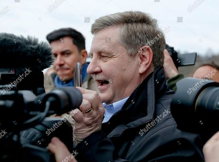 Republican Rick Saccone, holds his phone up as he says he is skyping with his son to show him all the cameras and reporters as he leaves the polling place after casting his ballot, in McKeesport, Pa. Saccone is running against Democrat Conor Lamb in a special election being held for the PA 18th Congressional District vacated by Republican Tim Murphy