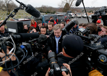Republican Rick Saccone, center, is makes his way through a gang of cameras and reporters as he heads to the polling place to cast his ballot, in McKeesport, Pa. Saccone is running against Democrat Conor Lamb in a special election being held for the PA 18th Congressional District vacated by Republican Tim Murphy